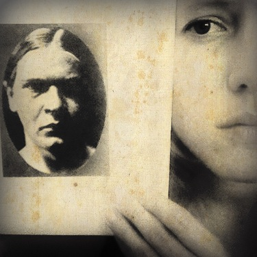 Kelli Anne Noftle with a photograph of Georg Trakl